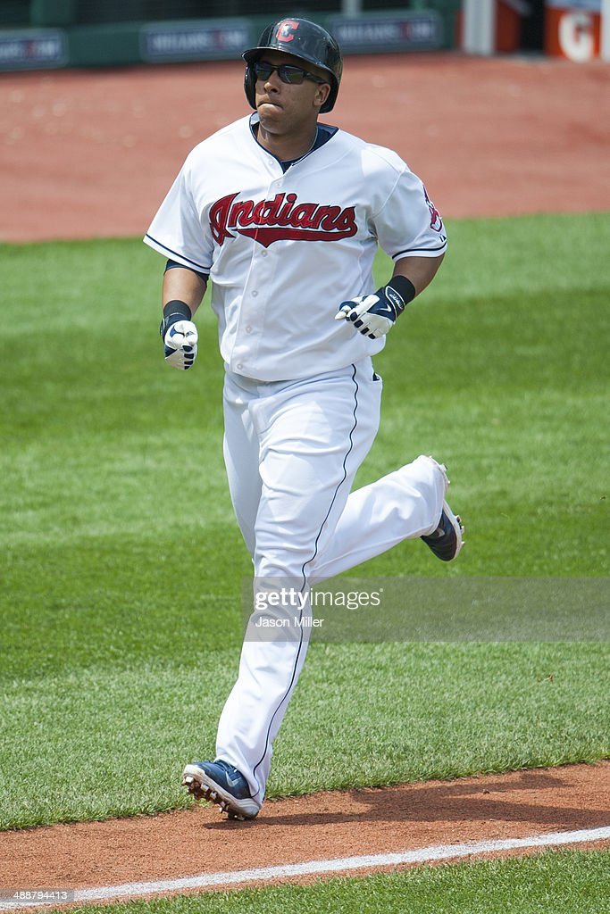 Michael Brantley #23 of the Cleveland Indians rounds the bases after hitting a two run home run during the fifth inning against the Minnesota Twins at Progressive Field on May 8, 2014 in Cleveland, Ohio.