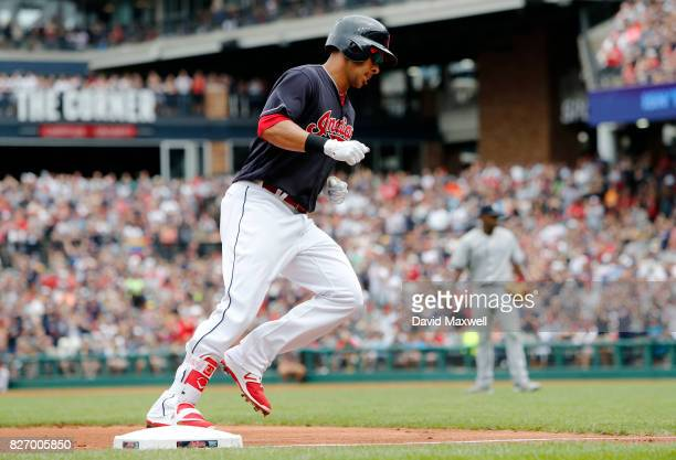 Michael Brantley of the Cleveland Indians rounds the bases after hitting a solo home run against Luis Severino the New York Yankees in the first...