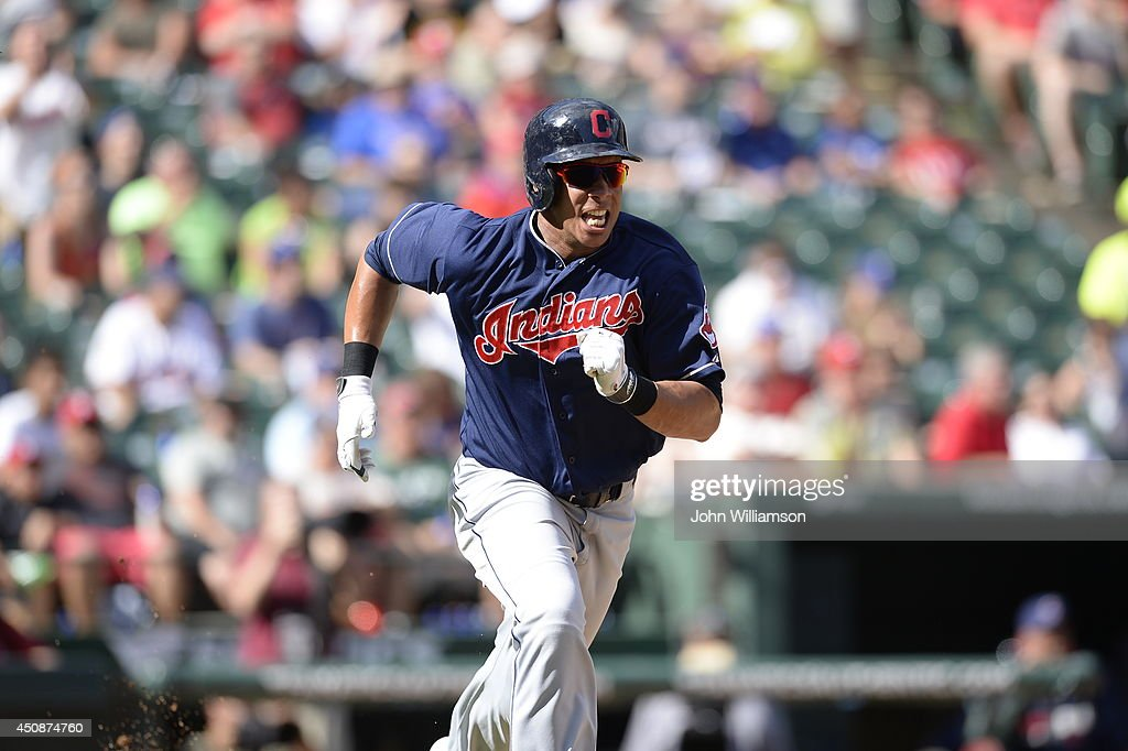 Michael Brantley #23 of the Cleveland Indians runs to first base after hitting the ball in the game against the Texas Rangers at Globe Life Park in Arlington on June 7, 2014 in Arlington, Texas. The Cleveland Indians defeated the Texas Rangers 8-3.