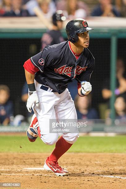 Michael Brantley of the Cleveland Indians singles during the eighth inning against the Chicago White Sox at Progressive Field on September 18 2015 in...