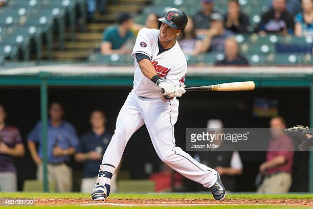 Michael Brantley of the Cleveland Indians singles during the first inning against the Houston Astros at Progressive Field on July 7 2015 in Cleveland...