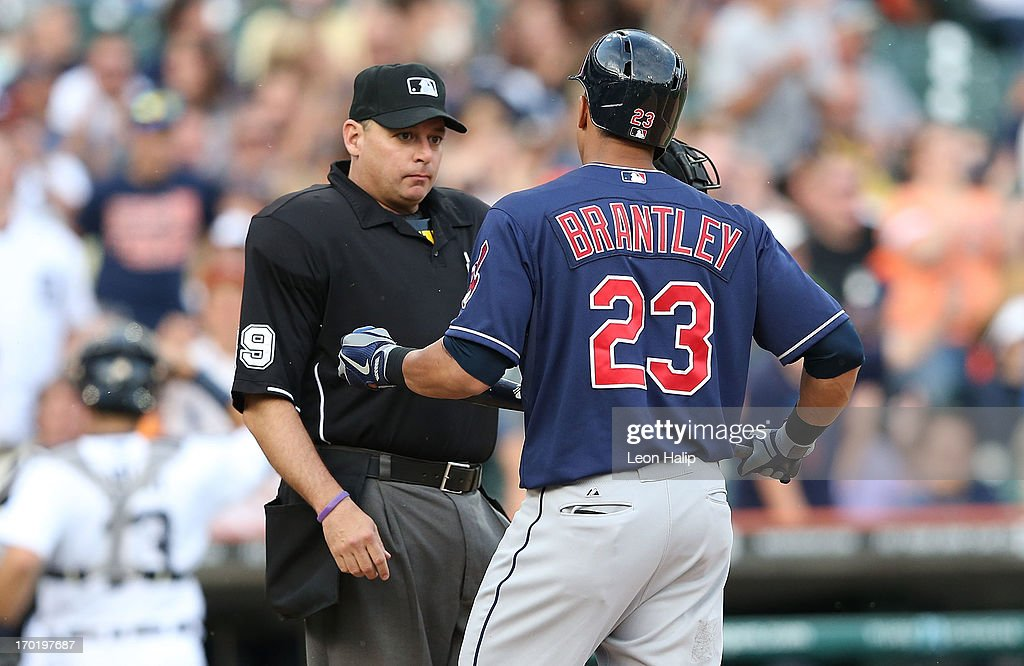 <a gi-track='captionPersonalityLinkClicked' href=/galleries/search?phrase=Michael+Brantley+-+Baseball+Player&family=editorial&specificpeople=5742247 ng-click='$event.stopPropagation()'>Michael Brantley</a> #23 of the Cleveland Indians strikes out and then has words with home plate umpire <a gi-track='captionPersonalityLinkClicked' href=/galleries/search?phrase=Andy+Fletcher+-+Baseball+Umpire&family=editorial&specificpeople=5537476 ng-click='$event.stopPropagation()'>Andy Fletcher</a> during the eighth inning of the game against the Detroit Tigers at Comerica Park on June 8, 2013 in Detroit, Michigan. The Tigers defeated the Indians 6-4.