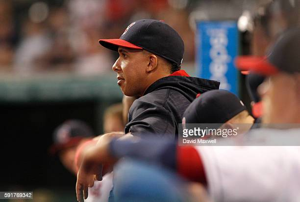 Michael Brantley of the Cleveland Indians watches from the dugout against the Los Angeles Angels of Anaheim during the first inning at Progressive...