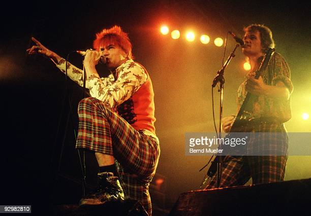 Michael Breitkopf and Campino of German punk band Die Toten Hosen perform on stage at the Jurahalle in Neumarkt Germany in September 1990