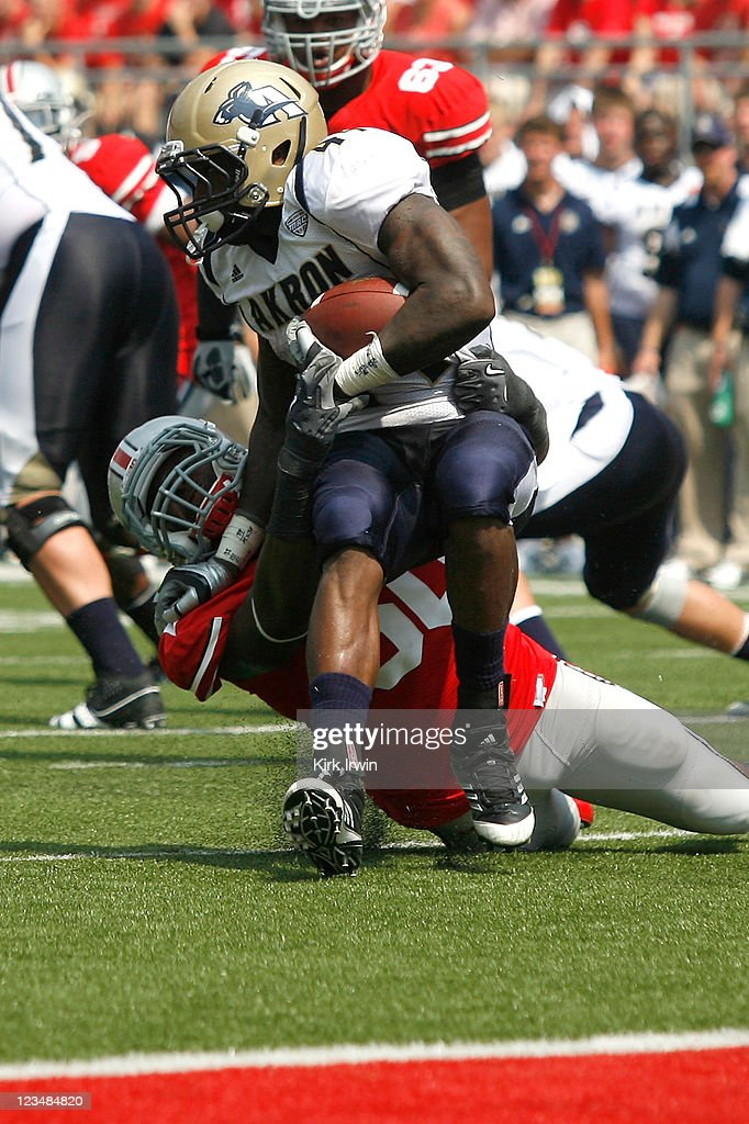 Michael Brewster #50 of the Ohio State Buckeyes tackles Jawon Chisholm #44 of the Akron Zips for a loss during the third quarter on September 3, 2011 at Ohio Stadium in Columbus, Ohio. Ohio State defeated Akron 42-0.