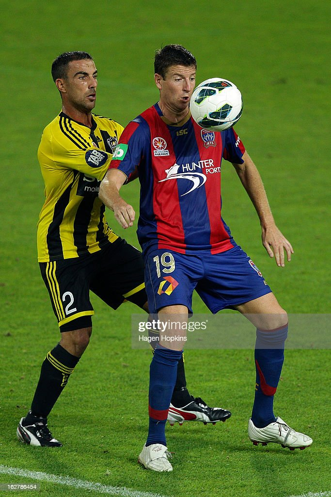 <a gi-track='captionPersonalityLinkClicked' href=/galleries/search?phrase=Michael+Bridges&family=editorial&specificpeople=233662 ng-click='$event.stopPropagation()'>Michael Bridges</a> of the Jets holds off the defence of Manny Muscat of the Phoenix during the round 26 A-League match between the Wellington Phoenix and the Newcastle Jets at Westpac Stadium on February 27, 2013 in Wellington, New Zealand.