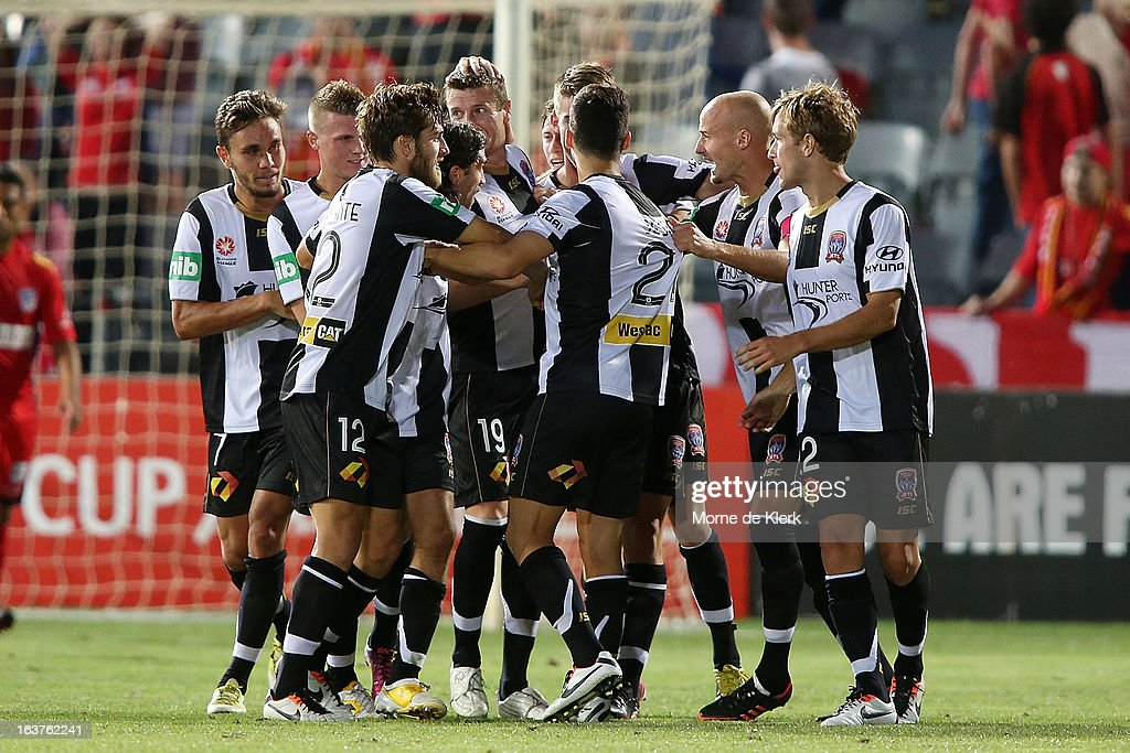 <a gi-track='captionPersonalityLinkClicked' href=/galleries/search?phrase=Michael+Bridges&family=editorial&specificpeople=233662 ng-click='$event.stopPropagation()'>Michael Bridges</a> of the Jets is congratulated by teammates after he scored a goal during the round 25 A-League match between Adelaide United and the Newcastle Jets at Hindmarsh Stadium on March 15, 2013 in Adelaide, Australia.