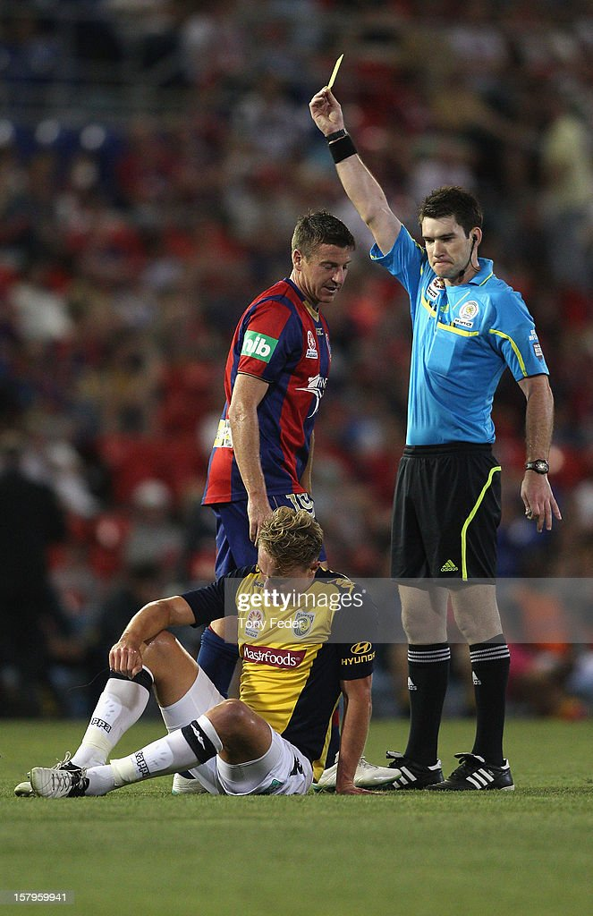 Michael Bridges of the Jets is shown a yellow card during the round ten A-League match between the Newcastle Jets and the Central Coast Mariners at Hunter Stadium on December 8, 2012 in Newcastle, Australia.