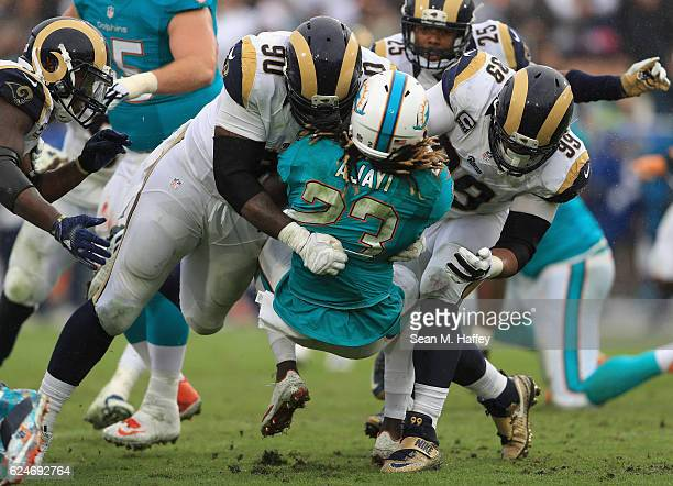 Michael Brockers and Aaron Donald of the Los Angeles Rams tackle Jay Ajayi of the Miami Dolphins in the third quarter of the game at Los Angeles...