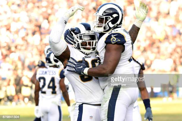 Michael Brockers of the Los Angeles Rams and Tyrunn Walker of the Los Angeles Rams celebrate a stop during third quarter of the game against the New...