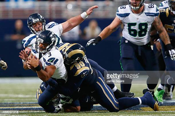 Michael Brockers of the St Louis Rams assists on the sack of Russell Wilson of the Seattle Seahawks in overtime to win the game 3431 at the Edward...