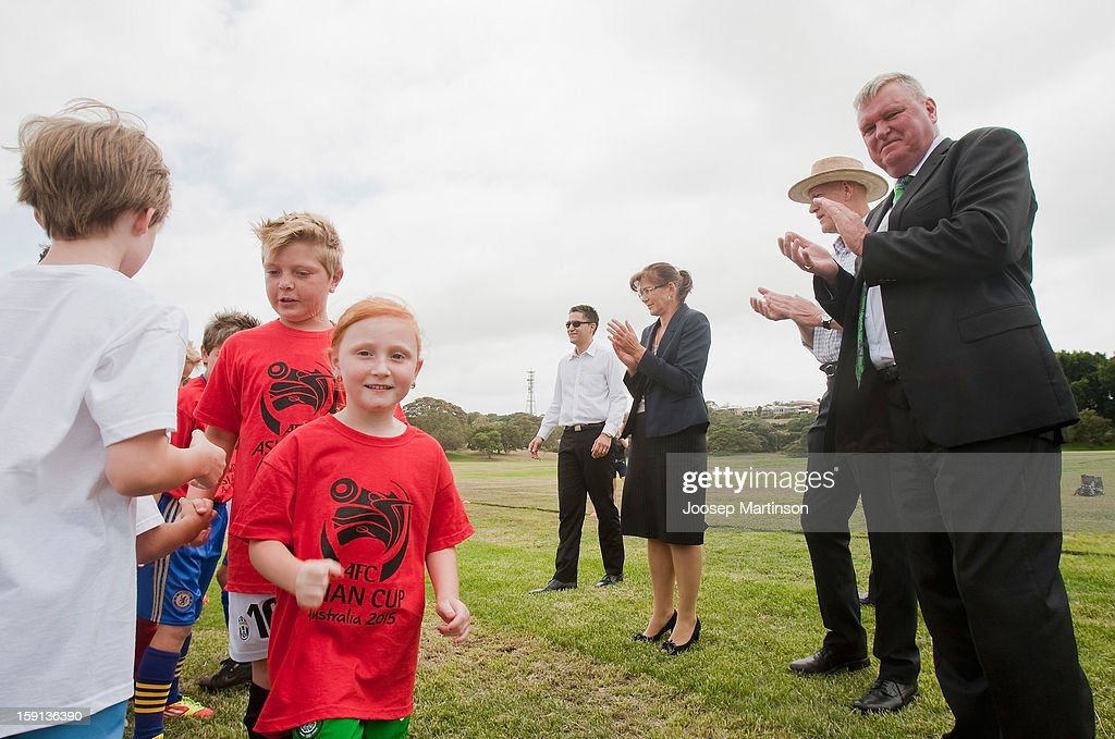 Michael Brown, <a gi-track='captionPersonalityLinkClicked' href=/galleries/search?phrase=Peter+Garrett&family=editorial&specificpeople=213494 ng-click='$event.stopPropagation()'>Peter Garrett</a> and Kate Lundy cheer with kids during a press conference at Queen's Park on January 9, 2013 in Sydney, Australia. Today marks two years until the 2015 Asian Cup held in Australia.
