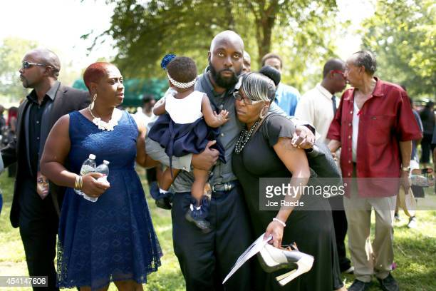Michael Brown Sr is hugged as he attends the burial ceremony for his son Michael Brown at St Peter's cemetery during the funeral service on August 25...