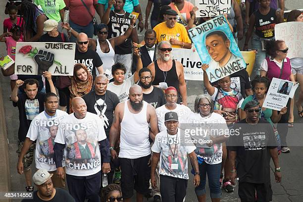 Michael Brown Sr leads a march from the location where his son Michael Brown Jr was shot and killed to Normandy High School where his son was a...