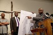 Michael Brown's family attorney's Benjamin Crump and Daryl Parks announce the findings of an autopsy during a press conference at the Greater St...