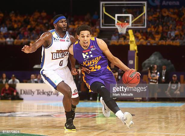 Michael Bryson of the Kings drives past Jermaine Beal of the Bullets during the round one NBL match between the Sydney Kings and the Brisbane Bullets...