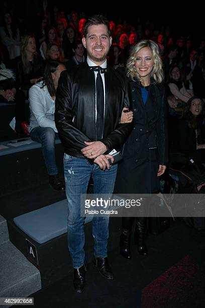 Michael Buble and wife Luisana Lopilato attend the catwalks during Madrid Fashion Week Fall/Winter 2015/16 at Ifema on February 8 2015 in Madrid Spain