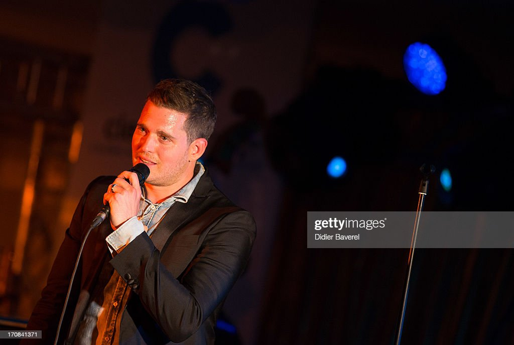 Michael Buble performs at Clear Channel Media and Entertainment and MediaLink VIP Event at Hotel Du Cap-Eden-Roc on June 18, 2013 in Cannes, France.