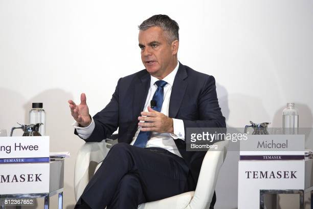Michael Buchanan head of strategy at Temasek International a unit of Temasek Holdings Pte speaks during a news conference for the company's annual...