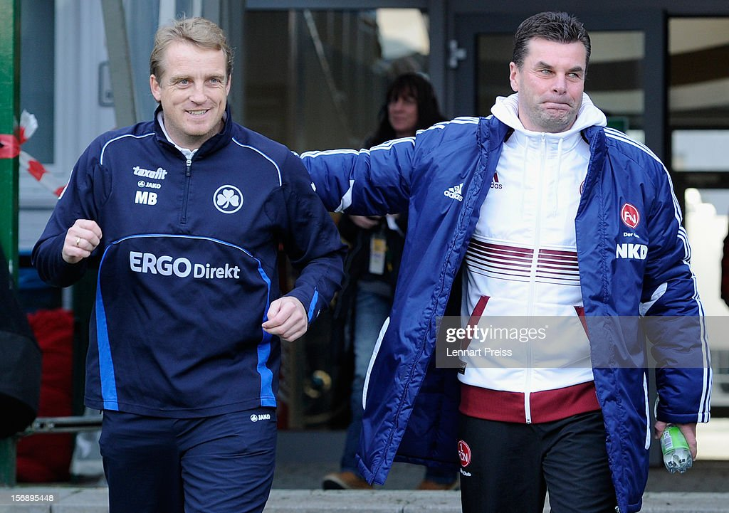Michael Bueskens (L), head coach of Fuerth and <a gi-track='captionPersonalityLinkClicked' href=/galleries/search?phrase=Dieter+Hecking&family=editorial&specificpeople=535775 ng-click='$event.stopPropagation()'>Dieter Hecking</a>, head coach of Nuernberg react before the Bundesliga match between SpVgg Greuther Fuerth and 1. FC Nuernberg at Trolli-Arena on November 24, 2012 in Fuerth, Germany.