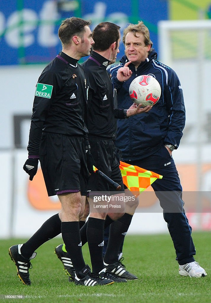 Michael Bueskens (R), head coach of Fuerth argues with the referee Marco Fitz (C) during the Bundesliga match between SpVgg Greuther Fuerth and 1. FSV Mainz 05 at Trolli-Arena on January 26, 2013 in Fuerth, Germany.