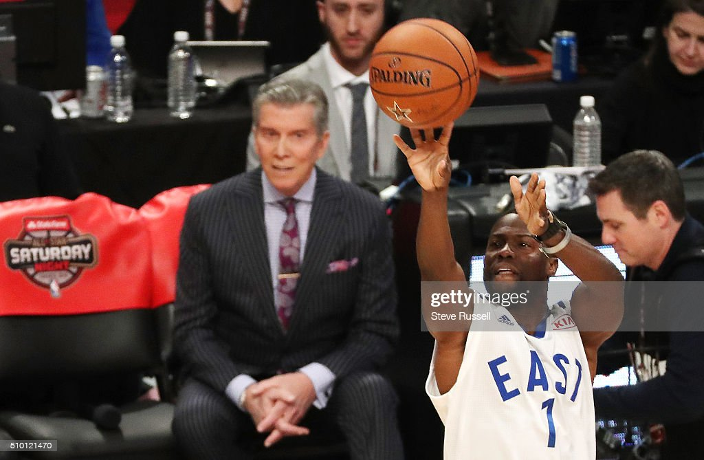 Michael Buffer watches Kevin Hart compete in the three point shootout during the NBA's All-Star Saturday Night. Where players compete in three events, the Skills Challenge, 3-point shooting and Slam Dunk at the in Toronto. February 13, 2016.