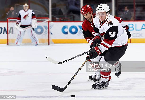 Michael Bunting of the Arizona Coyotes white team skates with the puck during the scrimmage game at Gila River Arena on September 24 2015 in Glendale...