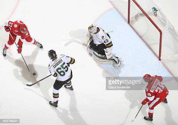 Michael Bunting of the Sault Ste Marie Greyhounds gets set to take a shot at Anthony Stolarz of the London Knights during an OHL game at the...