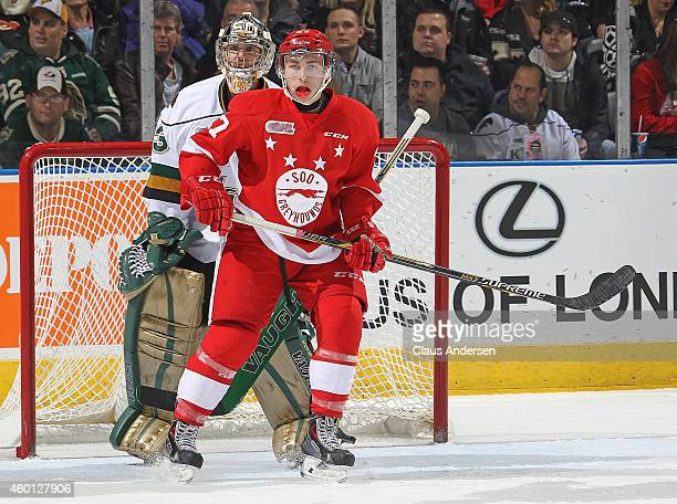 Michael Bunting of the Sault Ste Marie Greyhounds skates in front of Michael Giugovaz of the London Knights in an OHL game at Budweiser Gardens on...