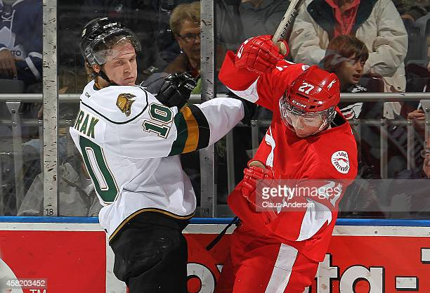 Michael Bunting of the Sault Ste Marie Greyhounds slams into Christian Dvorak of the London Knights in an OHL game at the Budweiser Gardens on...