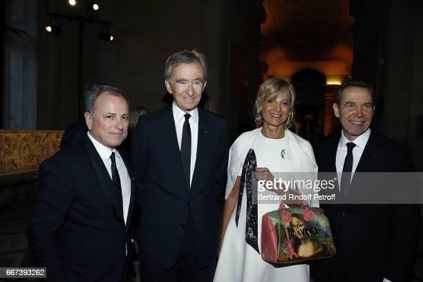 Michael Burke Bernard Arnault Helene Mercier Arnault and Jeff Koons attend the 'LVxKOONS' exhibition at Musee du Louvre on April 11 2017 in Paris...