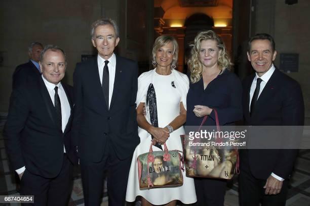 Michael Burke Bernard Arnault Helene Mercier Arnault Justine Wheller Koons and Jeff Koons attend the 'LVxKOONS' exhibition at Musee du Louvre on...