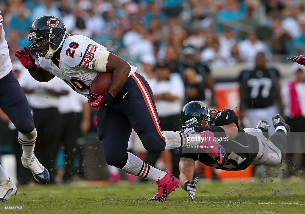 Michael Bush #29 of the Chicago Bears escapes a tackle from Paul Posluszny #51 of the Jacksonville Jaguars during a game at EverBank Field on October 7, 2012 in Jacksonville, Florida.