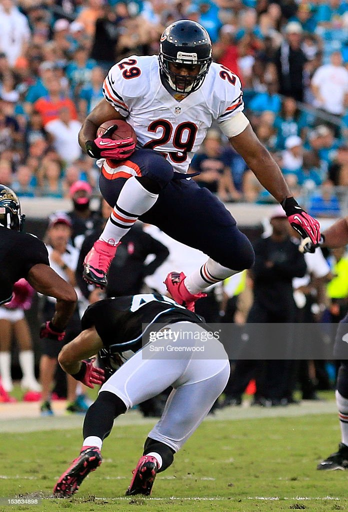 Michael Bush #29 of the Chicago Bears jumps over Chris Prosinski #42 of the Jacksonville Jaguars during the game at EverBank Field on October 7, 2012 in Jacksonville, Florida.