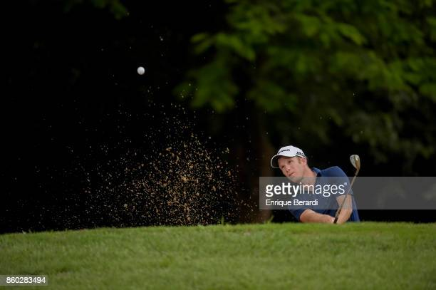 Michael Buttacavoli of the United States hits out of a bunker on the 17th hole during the final round of the PGA TOUR Latinoamérica Flor de Cana Open...