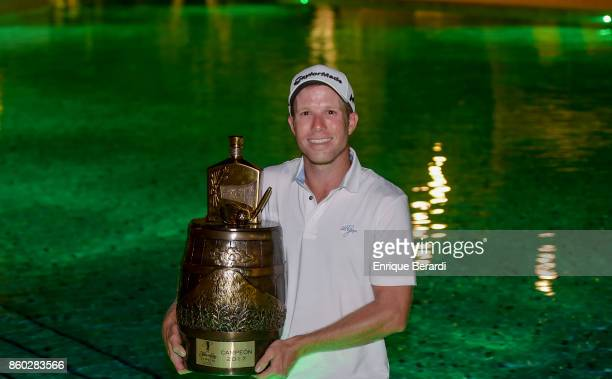 Michael Buttacavoli of the United States holds the trophy from the PGA TOUR Latinoamérica Flor de Cana Open at Mukul Beach Golf and Spa on September...