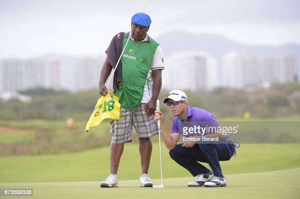 Michael Buttacavoli of the United States lines up a putt on the 18th hole during the final round of the PGA TOUR Latinoamerica 64 Aberto do Brasil at...