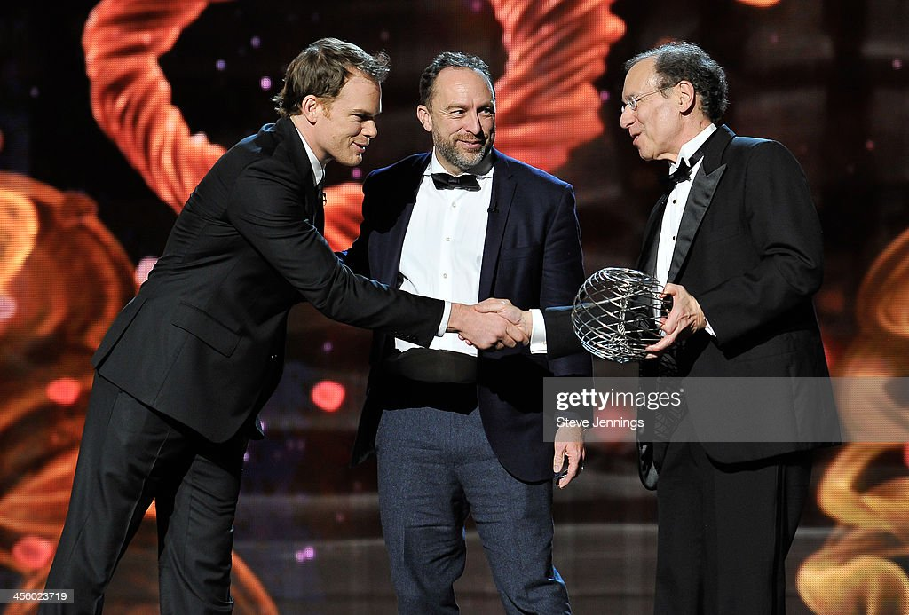 Michael C. Hall and Jimmy Wales (L-C) present an award to Robert S. Langer (R) at the 2014 Breakthrough Prizes Awarded in Fundamental Physics and Life Sciences Ceremony at NASA Ames Research Center on December 12, 2013 in Mountain View, California.
