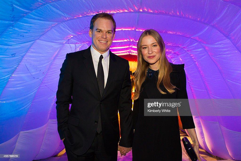 Michael C. Hall (L) poses for a photograph at NASA Ames Research Center on December 12, 2013 in Mountain View, California.