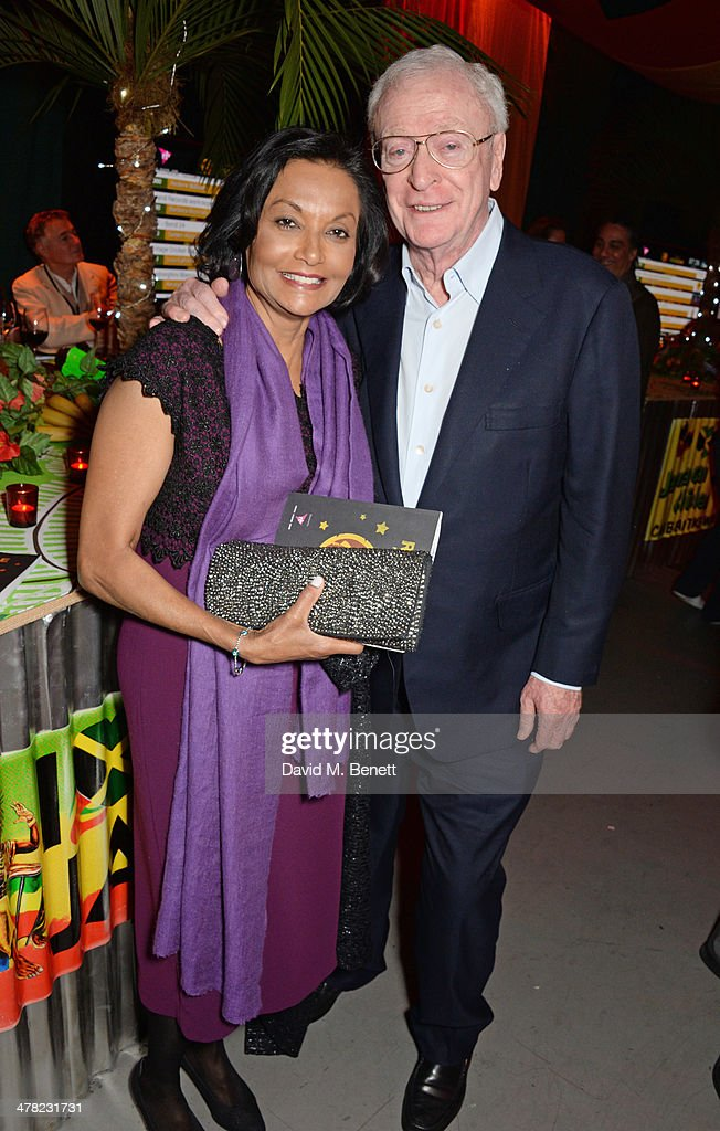 Michael Caine (R) and wife Shakira Caine attend 'A Night of Reggae' hosted by Helena Bonham Carter for Save The Children UK at The Roundhouse on March 12, 2014 in London, England.