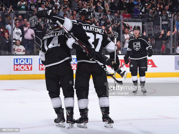 Michael Cammalleri Alec Martinez and Tyler Toffoli of the Los Angeles Kings celebrate a goal against the Montreal Canadiens at STAPLES Center on...