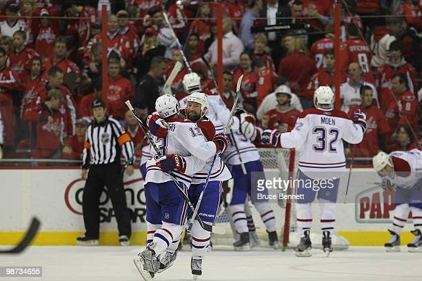 Michael Cammalleri and Glen Metropolit of the Montreal Canadiens embrace following their series winning 21 victory over the Washington Capitals in...