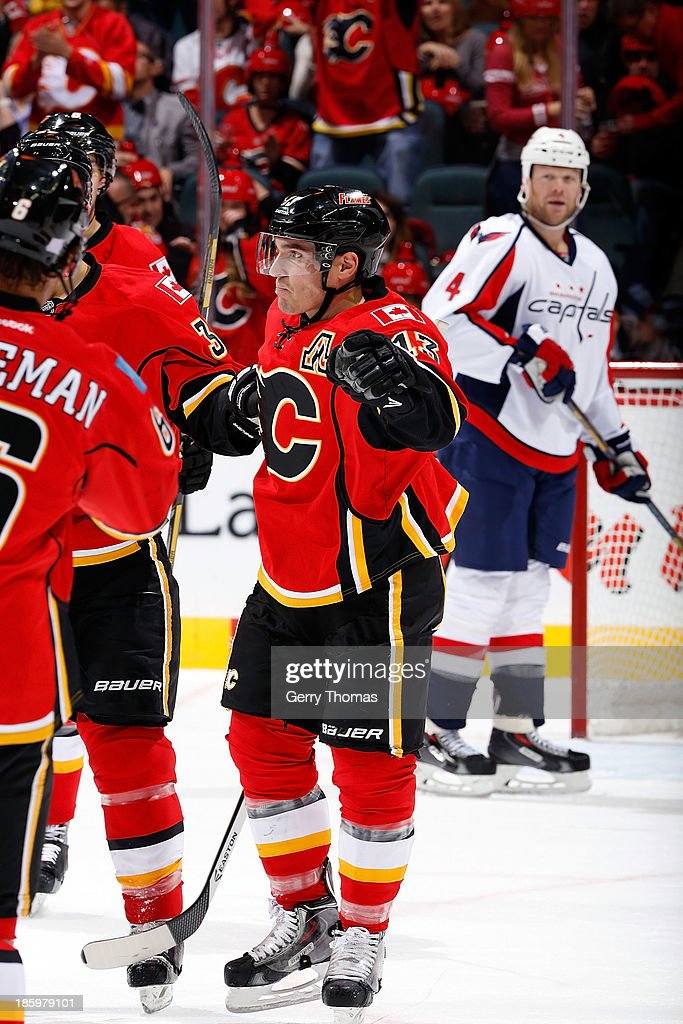 Michael Cammalleri #13 and teammates of the Calgary Flames celebrate a goal against the Washington Capitals at Scotiabank Saddledome on October 26, 2013 in Calgary, Alberta, Canada.