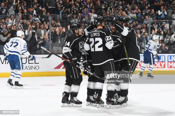 Michael Cammalleri and Trevor Lewis of the Los Angeles Kings celebrate with teammates after scoring a goal against the Toronto Maple Leafs at STAPLES...