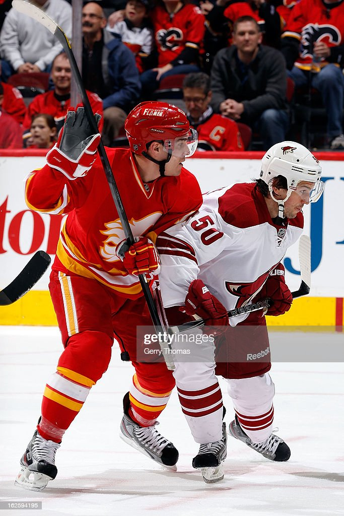 Michael Cammalleri #13 of the Calgary Flames skates against <a gi-track='captionPersonalityLinkClicked' href=/galleries/search?phrase=Antoine+Vermette&family=editorial&specificpeople=206302 ng-click='$event.stopPropagation()'>Antoine Vermette</a> #50 of the Phoenix Coyotes on February 24, 2013 at the Scotiabank Saddledome in Calgary, Alberta, Canada.