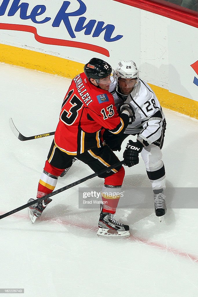 Michael Cammalleri #13 of the Calgary Flames skates against <a gi-track='captionPersonalityLinkClicked' href=/galleries/search?phrase=Jarret+Stoll&family=editorial&specificpeople=204632 ng-click='$event.stopPropagation()'>Jarret Stoll</a> #28 of the Los Angeles Kings on February 20, 2013 at the Scotiabank Saddledome in Calgary, Alberta, Canada.