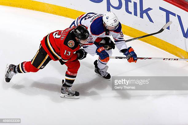 Michael Cammalleri of the Calgary Flames skates against Justin Schultz of the Edmonton Oilers at Scotiabank Saddledome on December 27 2013 in Calgary...