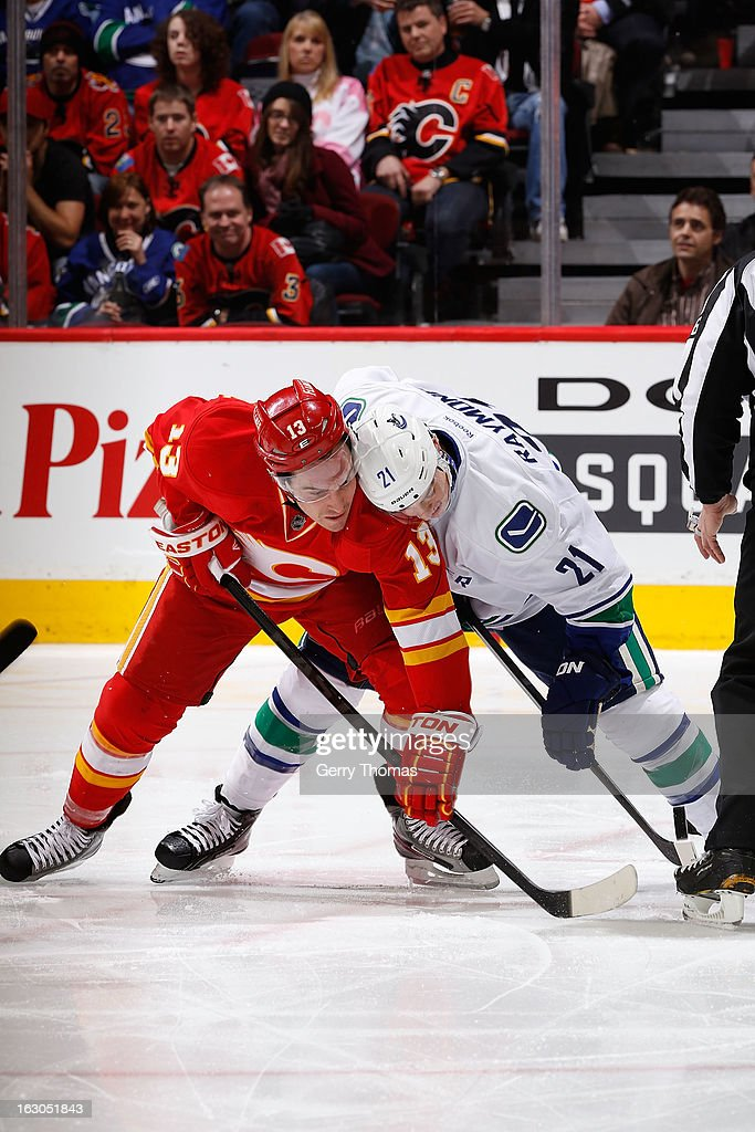 Michael Cammalleri #13 of the Calgary Flames skates against <a gi-track='captionPersonalityLinkClicked' href=/galleries/search?phrase=Mason+Raymond&family=editorial&specificpeople=4521385 ng-click='$event.stopPropagation()'>Mason Raymond</a> #21 of the Vancouver Canucks on March 3, 2013 at the Scotiabank Saddledome in Calgary, Alberta, Canada.