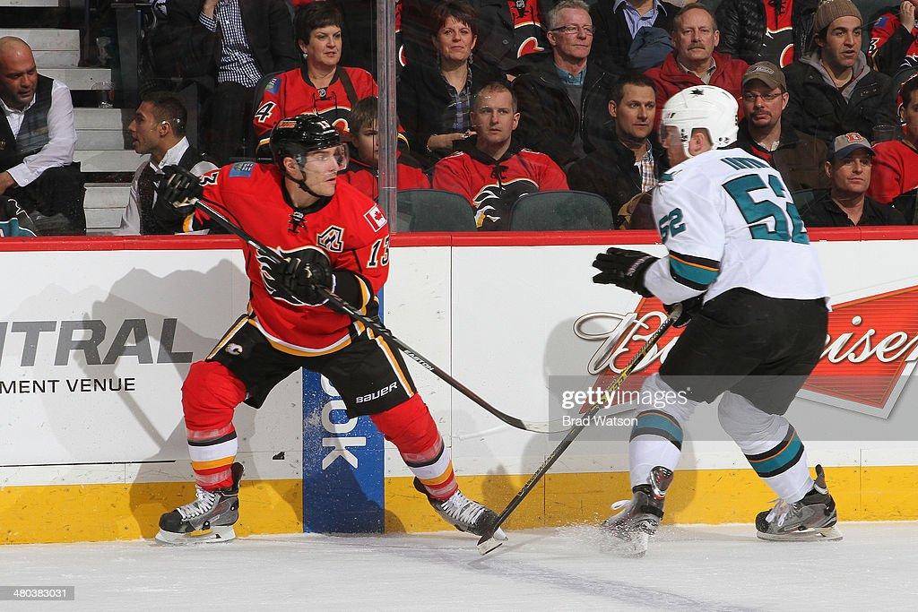 Michael Cammalleri #13 of the Calgary Flames skates against Matt Irwin #52 of the San Jose Sharks at Scotiabank Saddledome on March 24, 2014 in Calgary, Alberta, Canada.
