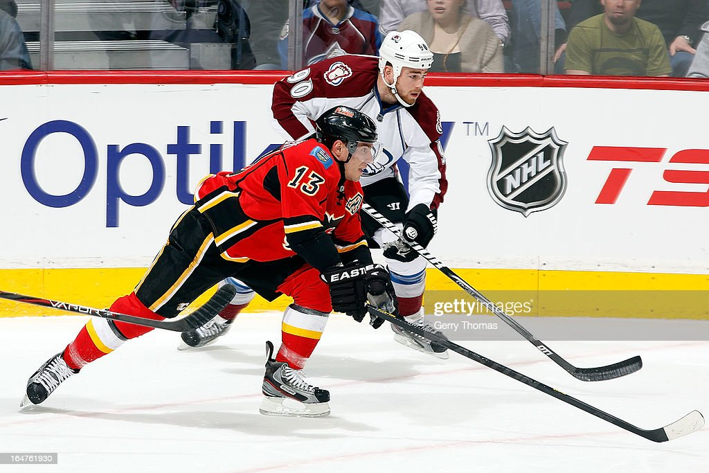 Michael Cammalleri #13 of the Calgary Flames skates against Ryan O'Reilly #92 of the Colorado Avalanche on March 27, 2013 at the Scotiabank Saddledome in Calgary, Alberta, Canada.